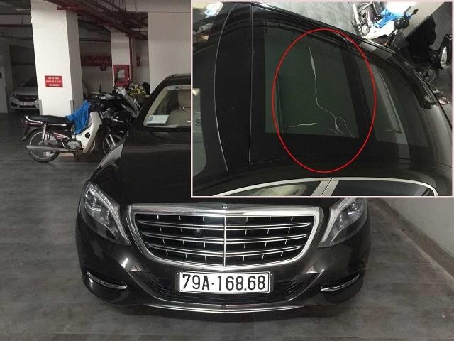 Chiếc xe Mercedes Benz mới trị giá lên tới 9,5 tỉ đồng (ảnh lớn) và ô kính bị nứt (ảnh nhỏ). Ảnh: NP