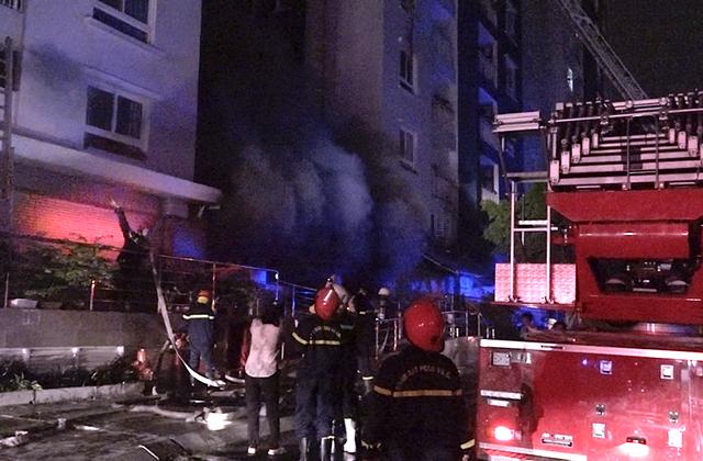 Hiện trường vụ cháy chung cư Carina Plaza khiến 13 người chết