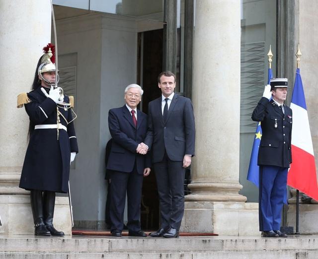 Tổng thống Cộng hòa Pháp Emmanuel Macron đón Tổng Bí thư Nguyễn Phú Trọng