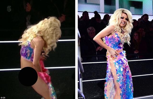 """Điều """"may mắn"""" là Courtney Act vẫn kịp giữ váy để giúp tình huống đỡ phần hớ hênh """"thảm họa"""". Toàn bộ sự cố dù vậy đã xuất hiện trên sóng truyền hình trực tiếp."""