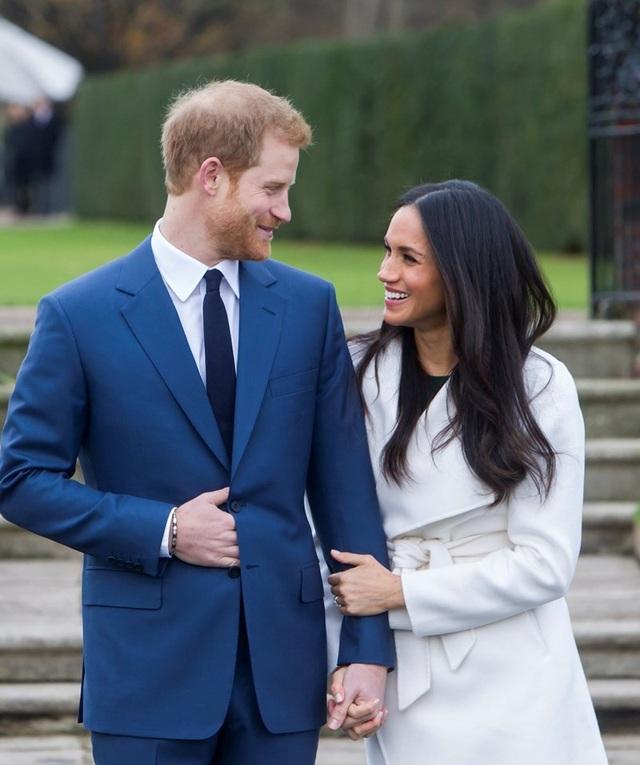 Hoàng tử Anh Harry và vị hôn thê người Mỹ Meghan Markle. Ảnh: Twitter
