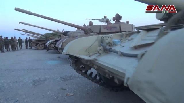 Trong số vũ khí mà phiến quân giao nộp cho quân đội Syria có hàng chục xe bọc thép. (Ảnh: SANA)