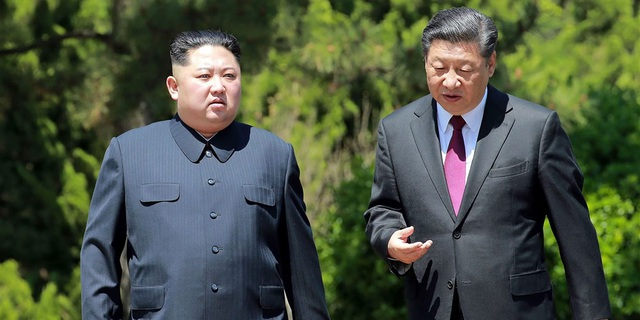 Nhà lãnh đạo Triều Tiên Kim Jong-un gần đây đã có chuyến thăm Trung Quốc 2 lần và gặp gỡ Chủ tịch Tập Cận Bình (Ảnh: AFP/Getty)