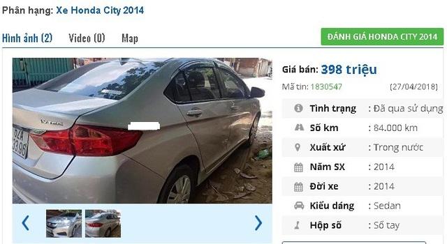 """Chiếc xe Honda City MT 2014, màu bạc này có giá bán 398 triệu đồng trên chợ xe hơi cũ. Người bán thông tin, """"xe còn nguyên bản, không đâm đụng hay ngập nước, máy nổ êm ru""""."""