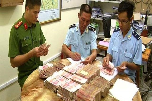 Kiểm tra, bắt giữ một vụ vận chuyển tiền trái phép (Ảnh minh họa/Lao động)