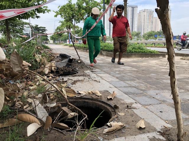 Hàng loạt nắp cống trên đại lộ đẹp nhất Sài Gòn bỗng dưng... mất tích - 9