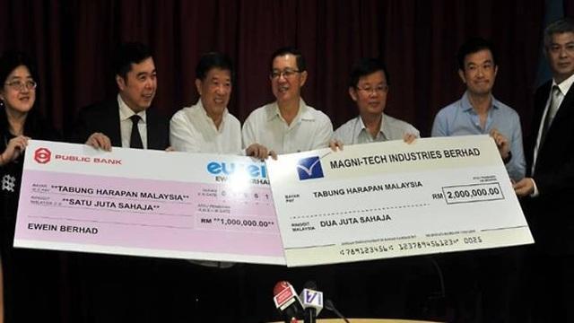 Nhiều doanh nghiệp Malaysia đã hưởng ứng lời kêu gọi hỗ trợ chính phủ trả nợ công. (Ảnh Bernama)