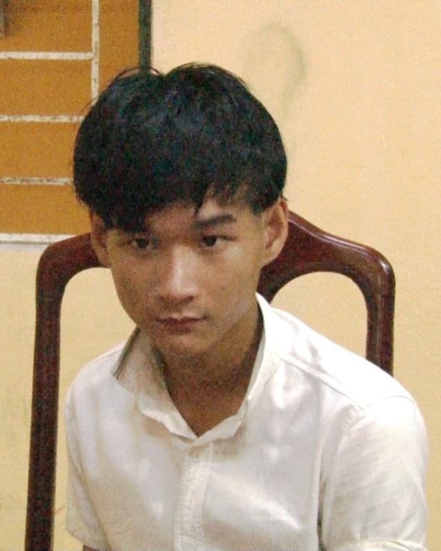 Đối tượng Trần Quang Huy tại cơ quan công an