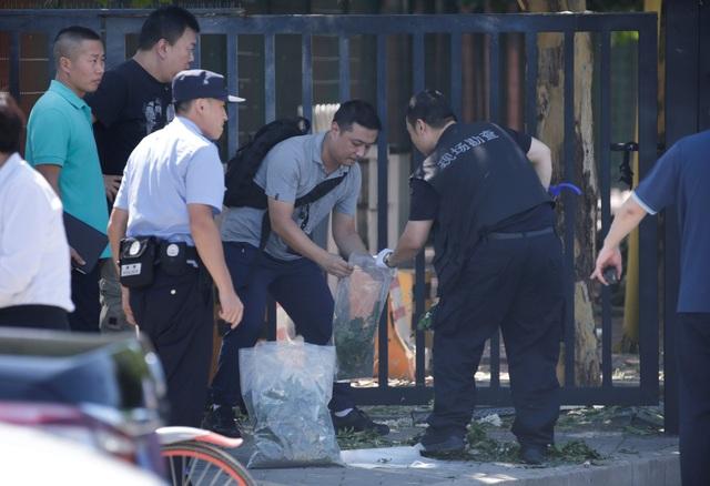 Lực lượng an ninh tại hiện trường vụ nổ (Ảnh: Reuters)