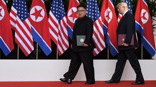 Tổng thống Trump và nhà lãnh đạo Kim Jong-un gặp nhau tại Singapore hồi tháng 6 (Ảnh: Reuters)