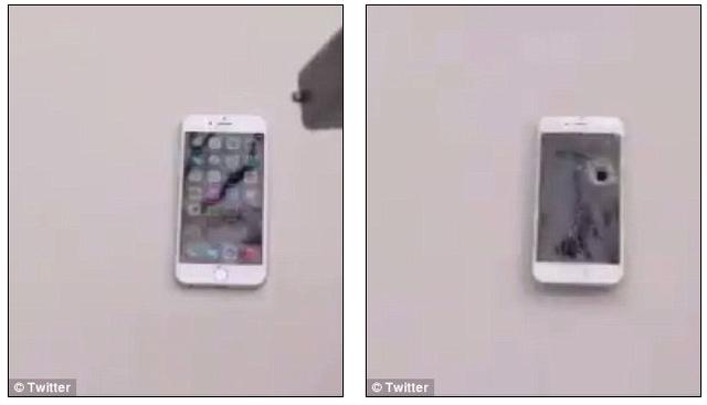 Một chiếc iPhone bị bắn thủng màn hình. (Ảnh: Twitter)