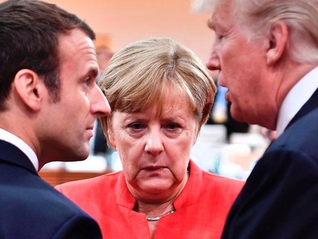 """Tổng thống Pháp Macron (trái), Thủ tướng Đức Merkel (giữa) đang thúc đẩy EU thoát khỏi ảnh hưởng từ các chính sách """"thất thường"""" của Tổng thống Trump. Ảnh: AFP"""
