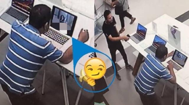 Người đàn ông Thái Lan xem phim khiêu dâm trong một cửa hàng máy tính đông người