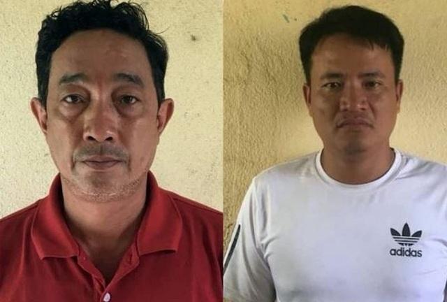 Phan Văn Dũng (áo đỏ) và Nguyễn Văn Uần tại cơ quan công an.