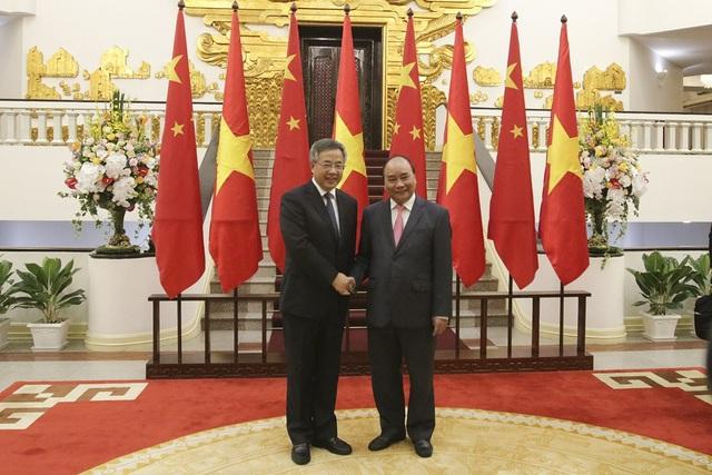 Thủ tướng Chính phủ Nguyễn Xuân Phúc và Phó Thủ tướng Quốc vụ viện Hồ Xuân Hoa (ảnh: Hữu Nghị)