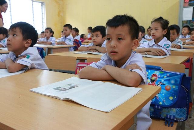 Học sinh tiểu học trong giờ học tiếng Việt ở Hà Nam. (Ảnh: Đ. Cường).