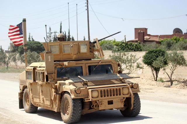 Cuộc tập trận bắn đạn thật của thủy quân lục chiến Mỹ với lực lượng nổi dậy ở Syria được cho là khá hiếm hoi. (Ảnh: Reuters)