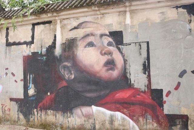 Bức họa về hình ảnh em bé ngây thơ trong sáng.