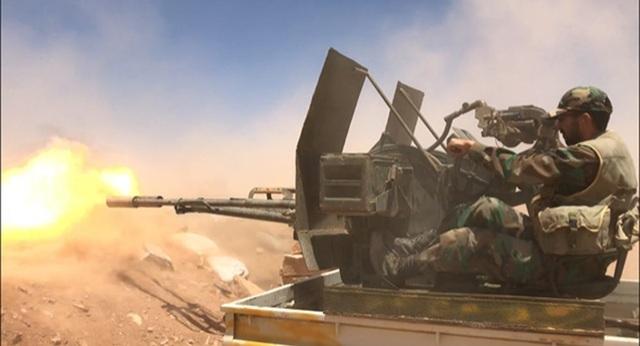Quân nhân Syria trong một trận chiến đấu (Ảnh: Sputnik)