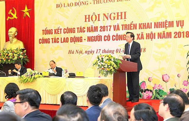 Bộ trưởng Đào Ngọc Dung báo cáo tại Hội nghị (Ảnh: MD)