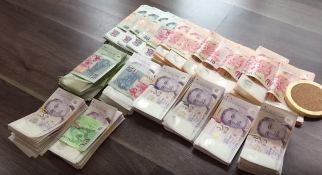 Mang 6,5 tỷ đồng sang Singapore mua điện thoại: Chàng trai Việt bị bắt ra tòa - 1