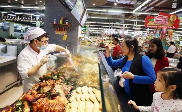 Người dân tấp nập vào siêu thị sắm Tết  - 6