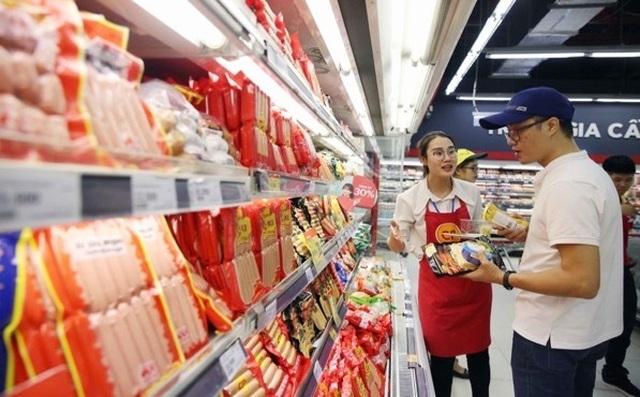 Người dân tấp nập vào siêu thị sắm Tết  - 9