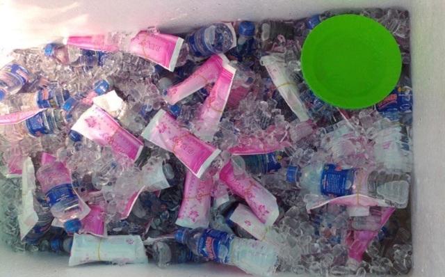Công an Đồng Tháp tặng nước suối, khăn lạnh... giải nhiệt cho người đi đường - 4