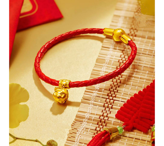 Mẫu thiết kế vòng charm heo vàng tinh xảo, đáp ứng nhu cầu thẩm mỹ người tiêu dùng..png