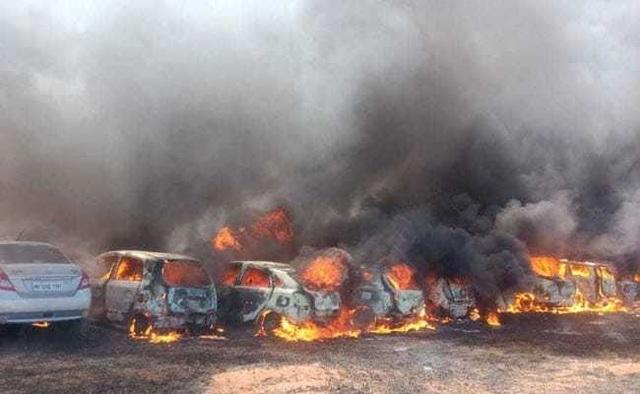 Hơn 300 xe bị thiêu rụi vì một điếu thuốc vứt ẩu - 1