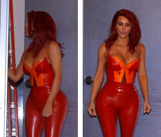 Kim Kardashian gây bất ngờ với tóc đỏ rực - 1