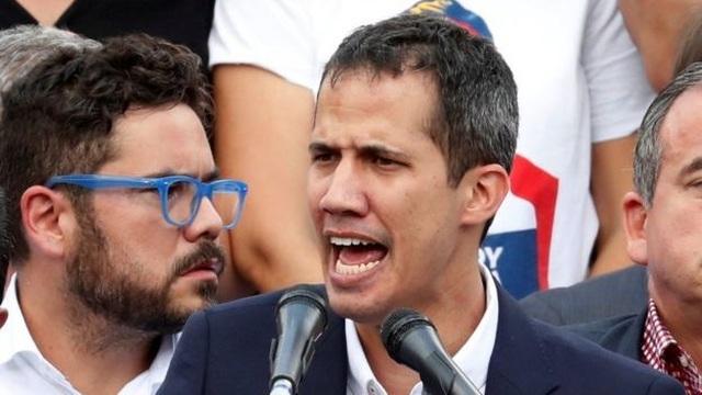 Tổng thống tự phong Venezuela về nước bất chấp đe dọa sẽ bị bắt - 1