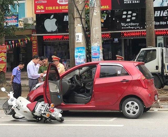 Bộ Công an giải đáp: Mở cửa xe ô tô gây tai nạn bị xử lý như thế nào? - 1