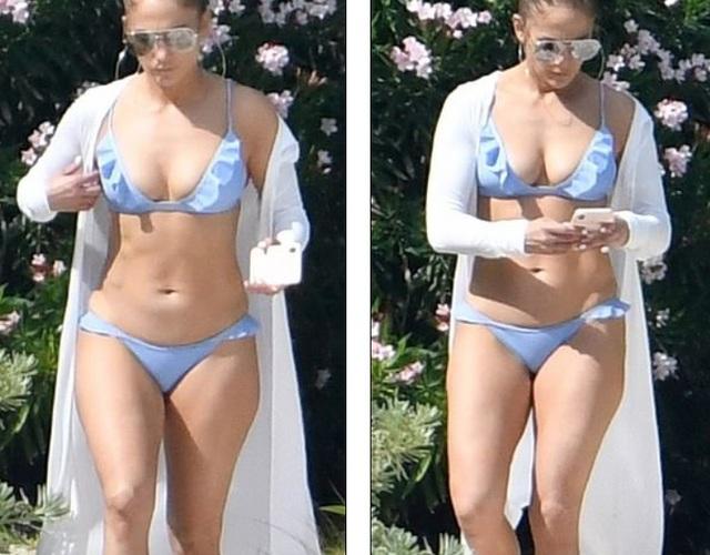 Jennifer Lopez khoe dáng săn chắc trên bãi biển - 1