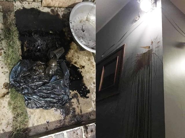 """Một phóng viên bị ném """"bom bẩn"""" vào nhà - 1"""