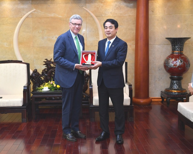 Ban Lãnh đạo Vietcombank tiếp và làm việc với đoàn lãnh đạo cấp cao Tổ chức thẻ quốc tế Visa - 4