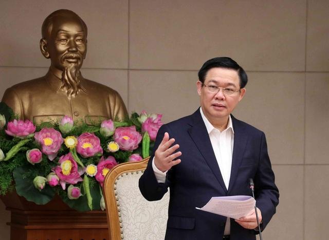 Nợ công, nợ nước ngoài của Việt Nam đang trên đà giảm - 1