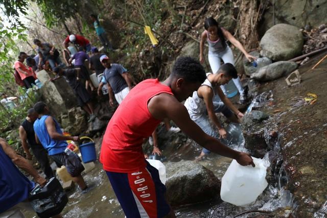 Cơn giận dữ của người Venezuela khi cuộc sống chìm trong bóng tối - 2