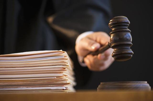 Ba người Mỹ gốc Việt lừa đảo 2 triệu USD từ cơ quan thuế  - 1
