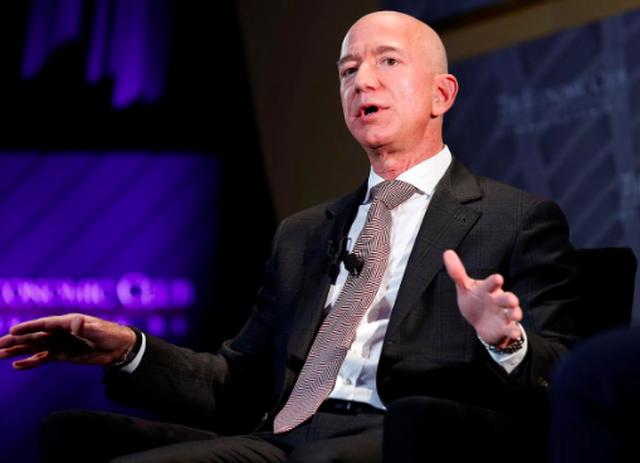 Amazon thách thức các đối thủ tăng lương cho nhân viên - 1