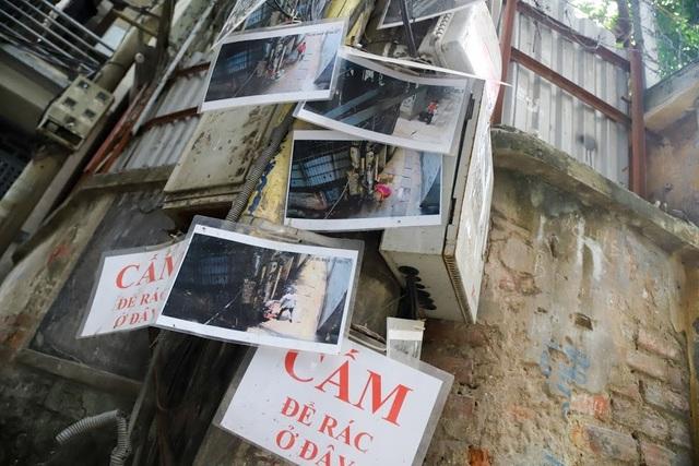 Chuyện lạ: Người đổ rác trộm bị treo ảnh, dán đầy trên cột điện ở Hà Nội - 3