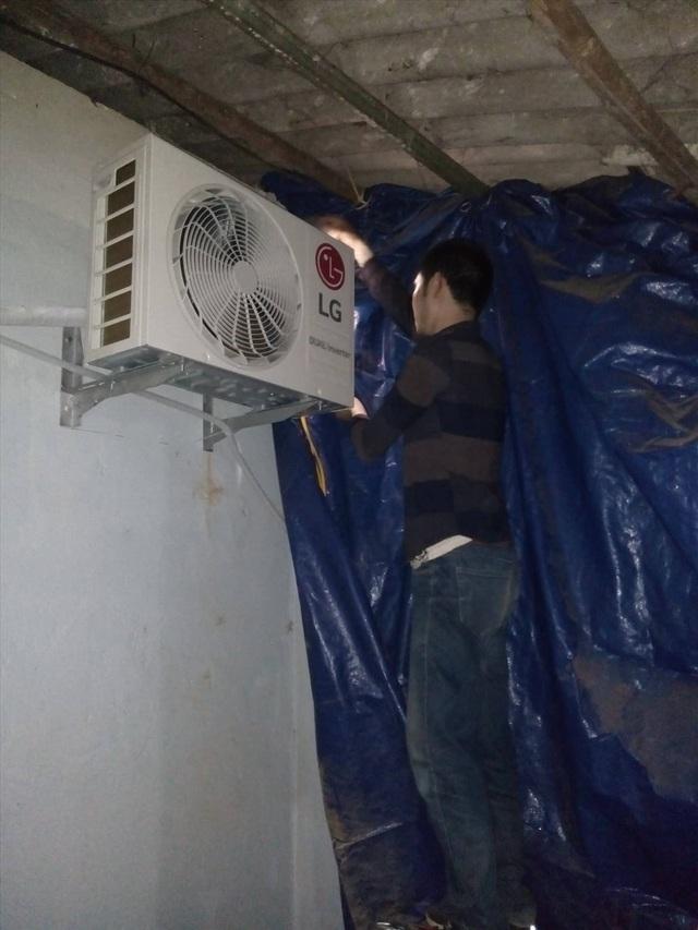 Thời tiết nắng nóng, Hà Nội cháy thợ điều hòa - 1