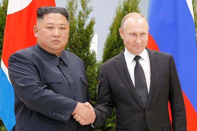 Ông Putin lần đầu gặp ông Kim Jong-un, ủng hộ Triều Tiên bình thường hóa quan hệ với Mỹ - 1