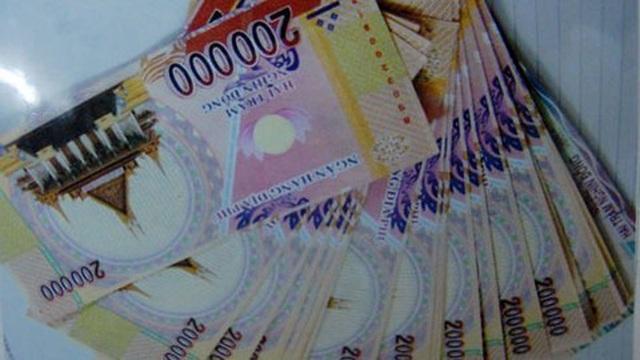 Khó tin: Tráo tiền âm phủ lấy hơn 7 tỷ đồng trong két ngân hàng - 5
