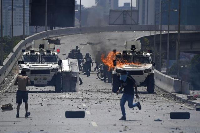 Nga cảnh báo hậu quả nặng nề nếu Mỹ tiếp tục can thiệp vào Venezuela - 1