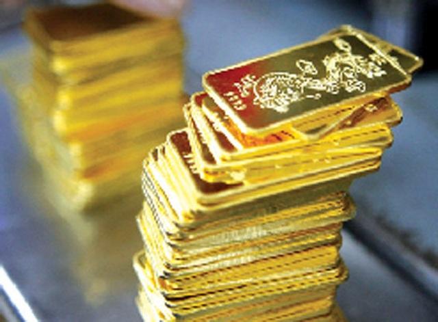 Giá vàng bật tăng phiên cuối tuần - 1