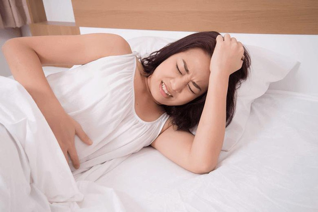 Bị đau bụng kinh, ra máu cục sau sinh con - Phải làm gì? - 1