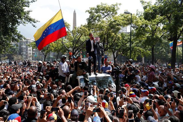 Người Venezuela lo ngại kịch bản Mỹ can thiệp quân sự - 1