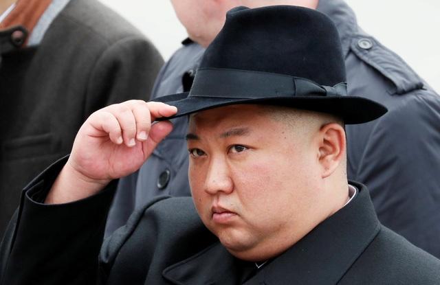 Ông Kim Jong-un vắng bóng bí ẩn sau các vụ phóng tên lửa - 1