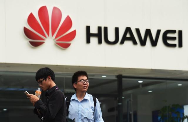 Huawei yêu cầu nhân viên Mỹ về nước sau lệnh cấm của Washington - 1